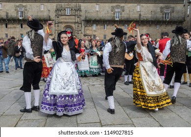 Santiago de Compostela. Spain. 03.25.17. Group of pilgrims dancing outside the cathedral in the holy city of Santiago-de-Compostela in the Galicia region of northwest Spain.