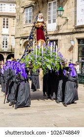 SANTIAGO DE COMPOSTELA, SPAIN - APRIL 3, 2015: Traditional Spanish Holy Week (Semana Santa) procession on Holy Friday in the streets of Santiago de Compostela (Galicia), Spain