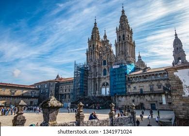 Santiago de Compostela, Spain - July 10, 2018: The Cathedral of Santiago de Compostela and view of the Praza do Obradoiro. A nice day with blue sky in Santiago de Compostela. The goal of the pilgrims
