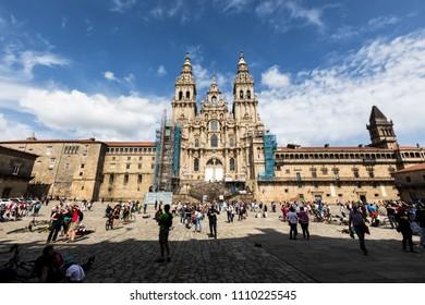 SANTIAGO DE COMPOSTELA, SPAIN - JUN 02, 2018: Facade of Santiago de Compostela cathedral in Obradoiro square. Santiago de Compostela street scene
