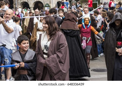 SANTIAGO DE COMPOSTELA, SPAIN - May 27, 2017: People disguised in Star Wars costumes for the III Imperial Stormtroopers parade 2017 in the Old City of Santiago de Compostela, Spain