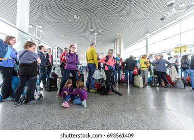 SANTIAGO DE COMPOSTELA, SPAIN - MAY 19, 2017: Passengers waiting in line at airport terminal before boarding Ryanair plane to Milano.