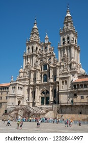 SANTIAGO DE COMPOSTELA; SPAIN - SEPTEMBER 1; 2018: Pilgrims in front of the cathedral of Santiago de Compostela; beautiful building with blue sky on September 1; 2018 in Galicia; Spain