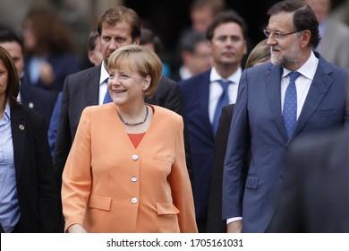 Santiago de Compostela-Spain. Angela Merkel, President of Germany, and Mariano Rajoy, President of Spain, walking through Santiago de Compostela on August 25, 2014