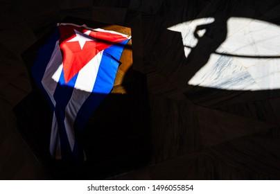 Santiago de Cuba, Cuba – 2019. The Cuban flag on a rock in Santa Ifigenia Cemetery - Fidel Castro tomb