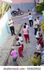 SANTIAGO DE CUBA,  CUBA - FEB 1, 2016: People exercise at the street in Santiago de Cuba, Cuba