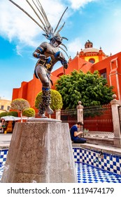 SANTIAGO DE QUERETARO, MEXICO - DECEMBER 16, 2016: Statue of dancing Indian in the city of Queretaro. The statue celebrates the strength and beauty of a native dancer from the period of the Conquest
