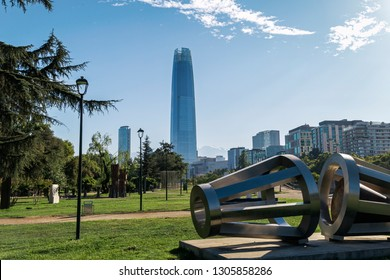 SANTIAGO, METROPOLITAN REGION, CHILE - JANUARY 27, 2019: View of the city from the Sculpture park next to the Mapocho river. Many buildings of the financial center in the background.