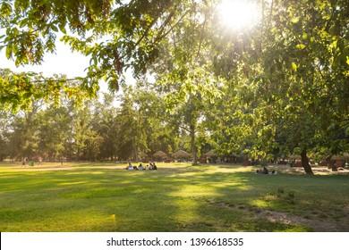 Santiago, Region Metropolitana, Chile - December 28, 2018: People enjoying a summer evening in Padre Hurtado Park at La reina district.