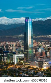 Santiago, Region Metropolitana, Chile - December 26, 2016: Gran Torre Santiago, tallest building in L. America, a 64-story tall skyscraper with view of ski centers in the back on The Andes mountains.