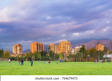 Santiago, Region Metropolitana, Chile - May 13, 2017: People gather and practice sports at Parque Juan Pablo II, an extension of Parque Araucano, forming the the mayor urban park in La Condes district