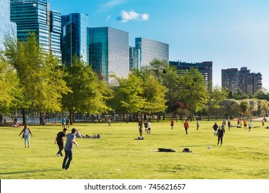 Santiago, Region Metropolitana, Chile - October 01, 2017: People gather and practice sports on the weekend at Parque Araucano, the mayor urban park in Las Condes district.