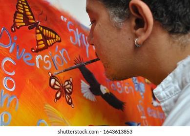 Santiago, Region Metropolitana/Chile; December 20 2010: Jorge Artus, Chilean painter, painting with his mouth.