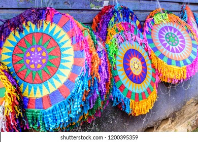 Santiago Sacatepequez, Guatemala - November 1, 2017: Display of handmade kites for sale in street as crowds head to giant kite festival honoring spirits of the dead in cemetery on All Saints Day.