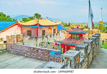 SANTICHON, THAILAND - MAY 5, 2019: Explore the fortress of Chinese Yunnan cultural village with stone walls, red lanterns, sculptures of dragons, foo dogs, sweeping roofs, on May 5 in Santichon