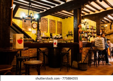 SANTILLANA DEL MAR, SPAIN - MAY 05, 2016: Unknown tourists enjoy the food on offer in a Spanish Sidreria in Santillana Del Mar on May 05, 2016.