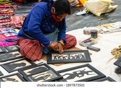 Santiniketan, West Bengal, India. January 16, 2021. An Unidentified Female Artisan making Handicrafts with Chisel.