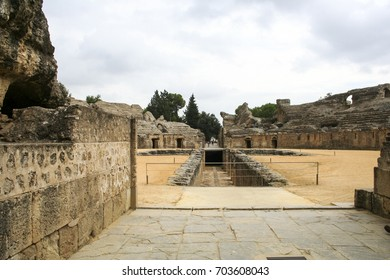 SANTIPONCE, SPAIN - October 7, 2009: The ruins of the Roman amphitheatre at Italica, an ancient city in Andalusia, Spain