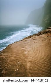 Santo Antao, Cape Verde - Sand dune on the hike trail from Cruzinha da Garca to Ponta do Sol. Moody Atlantic coastline with ocean waves
