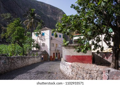 Santo Antao island, Cape Verde - august 27, 2015: Rural road and houses in a village with walls decorated by neighbors, in the Paul Valley, in the north of the island