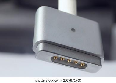 Santo André, Brazil - October 18 2021: A close up macro shot off an Apple Magsafe cord.