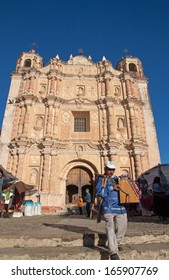 SANTO DOMINGO CHURCH, SAN CRISTOBAL DE LAS CASAS, MEXICO - FEBRUARY 8, 2013: It is one of the  major landmarks of the city with its open air crafts market.  Its facade is richly ornamented