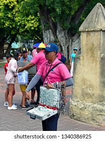 Santo Domingo, Dominican Republic - Feb 7, 2019:  Street vendor peddles Catholic rosaries and jewelry including some made with the popular Larimar gem which is only found in the the Dominican Republic
