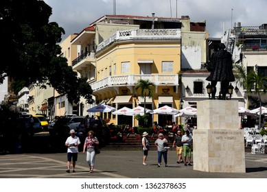 Santo Domingo, Dominican Republic - Feb 7, 2019:  Tourists visiting the historic Colonial Zone of Santo Domingo whick is the oldest permanent European settlement of the Americas.