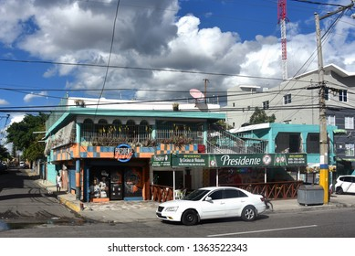 Santo Domingo, Dominican Republic - February 7, 2019:  Restaurant La Cocina de Natasha in Santo Domingo Este featuring signage for the popular Dominican beer Presidente beer.