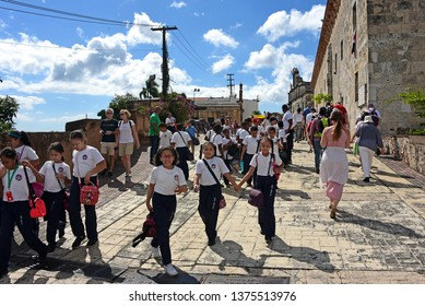 Santo Domingo, Dominican Republic - February 7, 2019:  A group of Dominican school children n the historic Colonial Zone of Santo Domingo, which is the oldest permanent European settlement in Americas