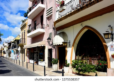 Santo Domingo, Dominican Republic - February 7, 2019:  Row of historic buildings near Calle Arzobispo Merino in the historic Colonial Zone of Santo Domingo a UNESCO World Heritage Site