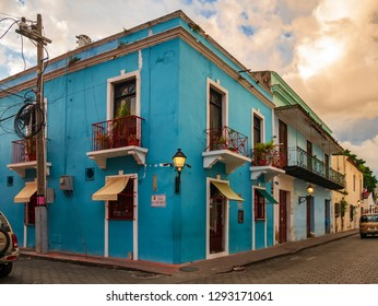 SANTO DOMINGO - DOMINICAN REPUBLIC - January 19, 2019 : Street view of old town zona colonial concentrated on blue colored colonial house architecture Santo Domingo.