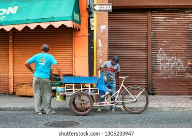SANTO DOMINGO - DOMINICAN REPUBLIC - January 26, 2019 : Street salesman and a client in the streets of old town zona colonial of Santo Domingo Dominican Republic.