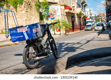 SANTO DOMINGO - DOMINICAN REPUBLIC - January 30, 2019 : Motorcycle parked in the street. Motorcycle is  common way of transportation in Santo Domingo Dominican Republic.