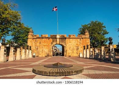 SANTO DOMINGO - DOMINICAN REPUBLIC - January 19, 2019 : People visit Parque Independencia of Santo Domingo old town with flags of Dominican Republic.