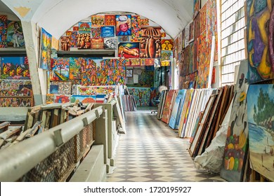 SANTO DOMINGO , DOMINICAN REPUBLIC - January 26, 2019: Local art gallery includes samples of Caribbean art and Haitian art colorful paintings located in Santo Domingo City old town.