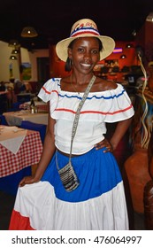 SANTO DOMINGO, DOMINICAN REPUBLIC - January 24: Girl in traditional Dominican dress. Street life and view of Calle el Conde. January 24, 2016 Santo Domingo, Dominican Republic.