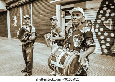 SANTO DOMINGO, DOMINICAN REPUBLIC - January 24: Merengueros in Calle el Conde, Colonial Zone. Lith version of the shot. Taken in January 24, 2016 in Santo Domingo, Dominican Republic.