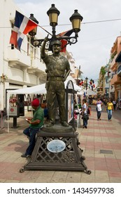 Santo Domingo, Dominican Republic - November 08, 2012: Statue of the coronel Francisco Alberto Caamano  at the pedestrian street in Santo Domingo, Dominican Republic.