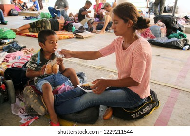 Santo Domingo Ingenio, Oaxaca/Mexico - Nov. 7, 2018:  A young Honduran woman fleeing poverty and gang violence in the second caravan to the U.S. feeds her child at an impromptu migrant shelter.