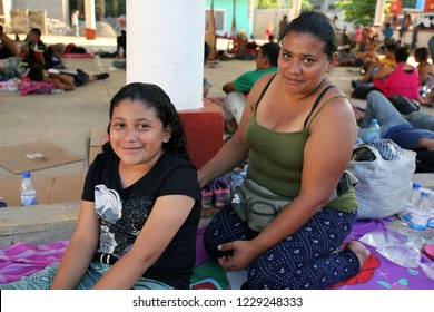 Santo Domingo Ingenio, Oaxaca/Mexico - Nov. 7, 2018:  A Honduran woman fleeing poverty and gang violence in the second caravan to the U.S. combs her daughter's hair at an impromptu migrant shelter.