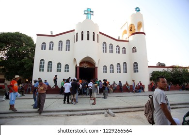 Santo Domingo Ingenio, Oaxaca/Mexico - Nov. 7, 2018:  Hondurans fleeing poverty and gang violence in the second caravan to the U.S. gather in front of a church at an impromptu migrant shelter.