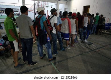 Santo Domingo Ingenio, Oaxaca/Mexico - Nov. 7, 2018:  Hondurans fleeing poverty and gang violence in the second caravan to the U.S. line up for free clothes at a migrant shelter at a municipal park.