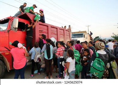 Santo Domingo Ingenio, Oaxaca/Mexico - Nov. 8, 2018:  Hondurans fleeing poverty and gang violence in the second caravan to the U.S. wait to climb onto a truck at dawn to ride to their next stop.
