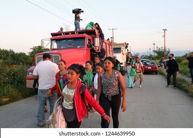 Santo Domingo Ingenio, Oaxaca/Mexico - Nov. 8, 2018: Honduran women fleeing poverty and gang violence in the second caravan to the U.S. walk to a truck at dawn to ride to their next stop.
