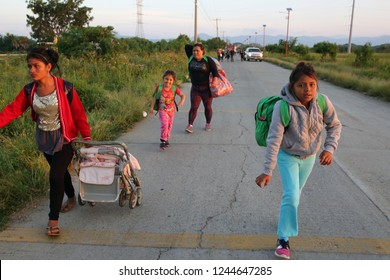 Santo Domingo Ingenio, Oaxaca/Mexico - Nov. 8, 2018: Two Honduran women and their daughters fleeing poverty and gang violence in the second caravan to the U.S. walk to get a truck to their next stop.