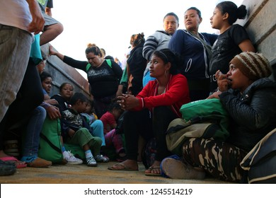 Santo Domingo Ingenio, Oaxaca/Mexico - Nov. 8, 2018: A Honduran woman fleeing poverty and gang violence in the second caravan to the U.S. uses an inhaler while sitting in a dump truck.