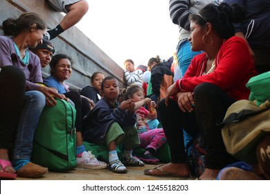 Santo Domingo Ingenio, Oaxaca/Mexico - Nov. 8, 2018: Honduran women and children fleeing poverty and gang violence in the second caravan to the U.S. sit in a dump truck taking them to their next stop.