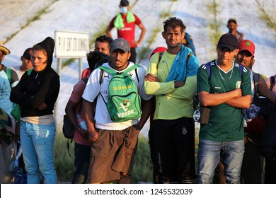 Santo Domingo Ingenio, Oaxaca/Mexico - Nov. 8, 2018: Hondurans fleeing poverty and gang violence in the second caravan to the U.S. wait by the side of the road for transportation to their next stop.