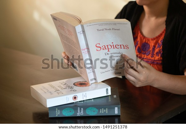 "SANTO DOMINGO/DOMINICAN REPUBLIC - AUGUST 23, 2019: Woman reads Yuval Noah Harari book ""Sapiens: A Brief History of Humankind "", Spanish edition. Best seller about human evolution and science history."